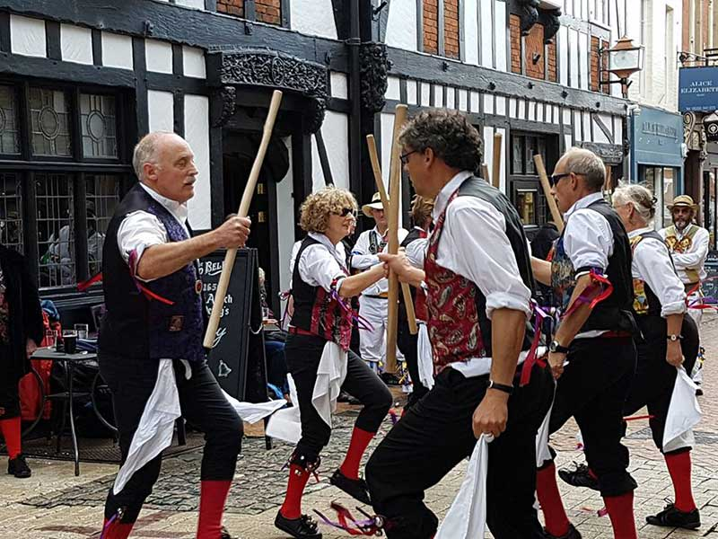 Lady Bay Revellers Morris Dancing in red and black